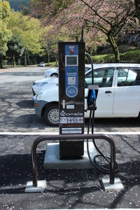 Electric car battery charger is in parking lot