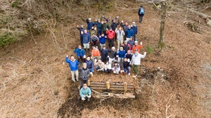 Bench and observation deck of thinnings are completed by hand of local volunteers