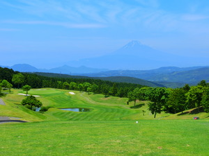 Mount Fuji is seen on the other side of hill course where fairway is large